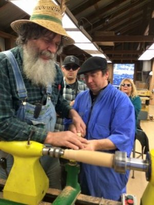 Photo of George Wurtzel Teaching Woodworking at Enchanted Hills Camp