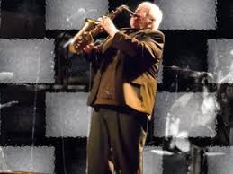Photo of Brian Snowman Powers playing the Saxophone on stage.