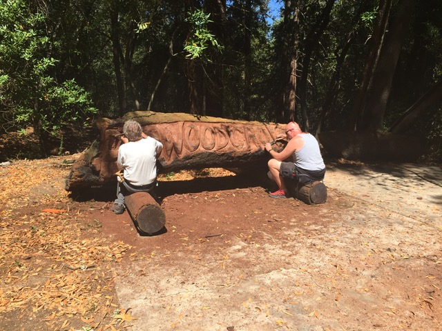 Jerry K and fellow wood worker carving out the Redwood Grove sign.