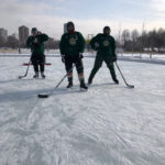 Photo of Jeff, Nick and Tim preparing for the Minnesota Hockey Day 2020 event.